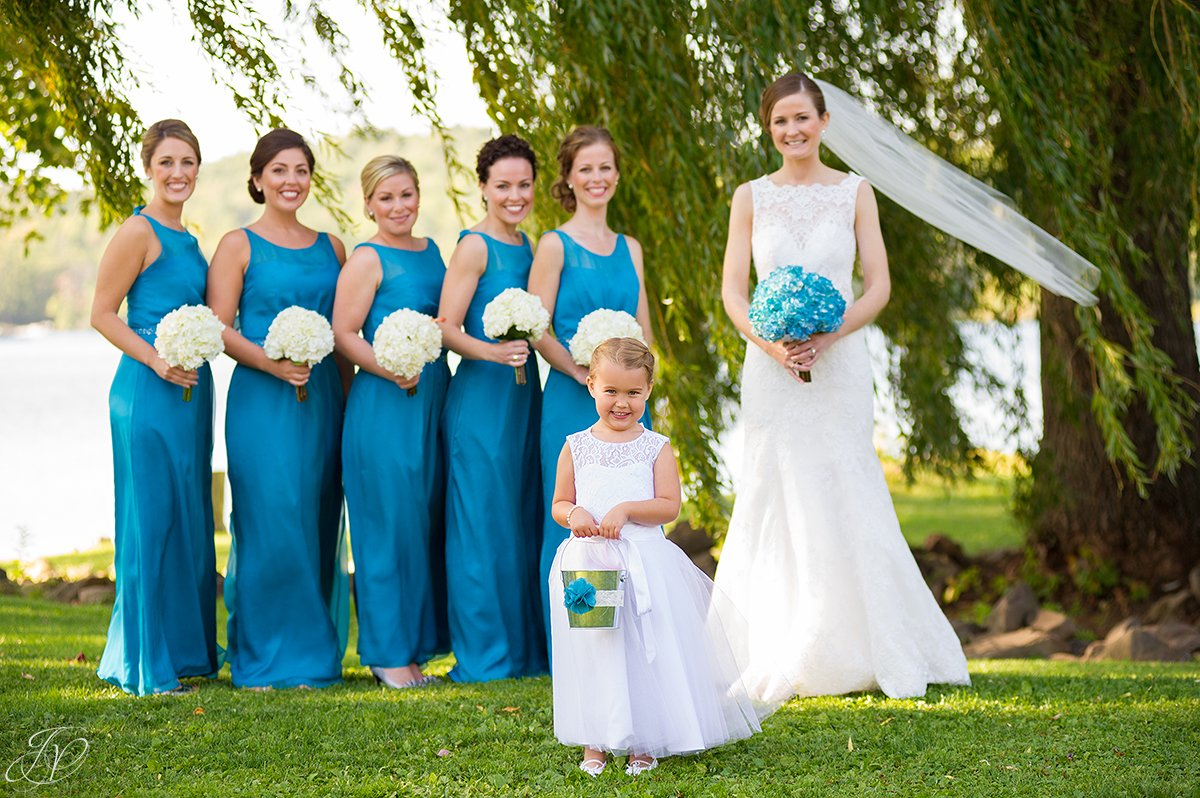adorable flower girl with bridesmaids