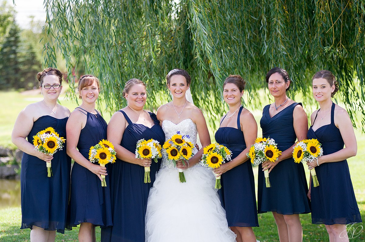 bridesmaids in dark blue with sunflowers