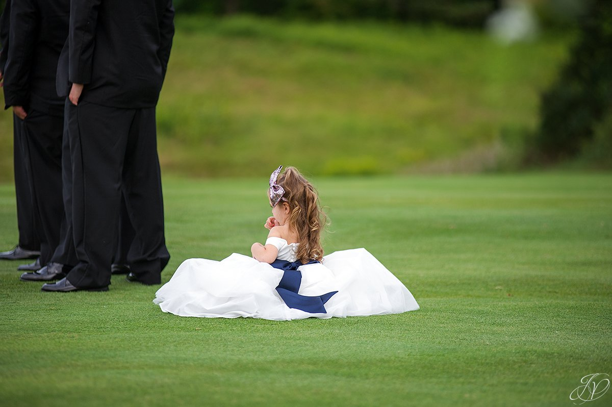 very sweet flower girl next to groomsmen