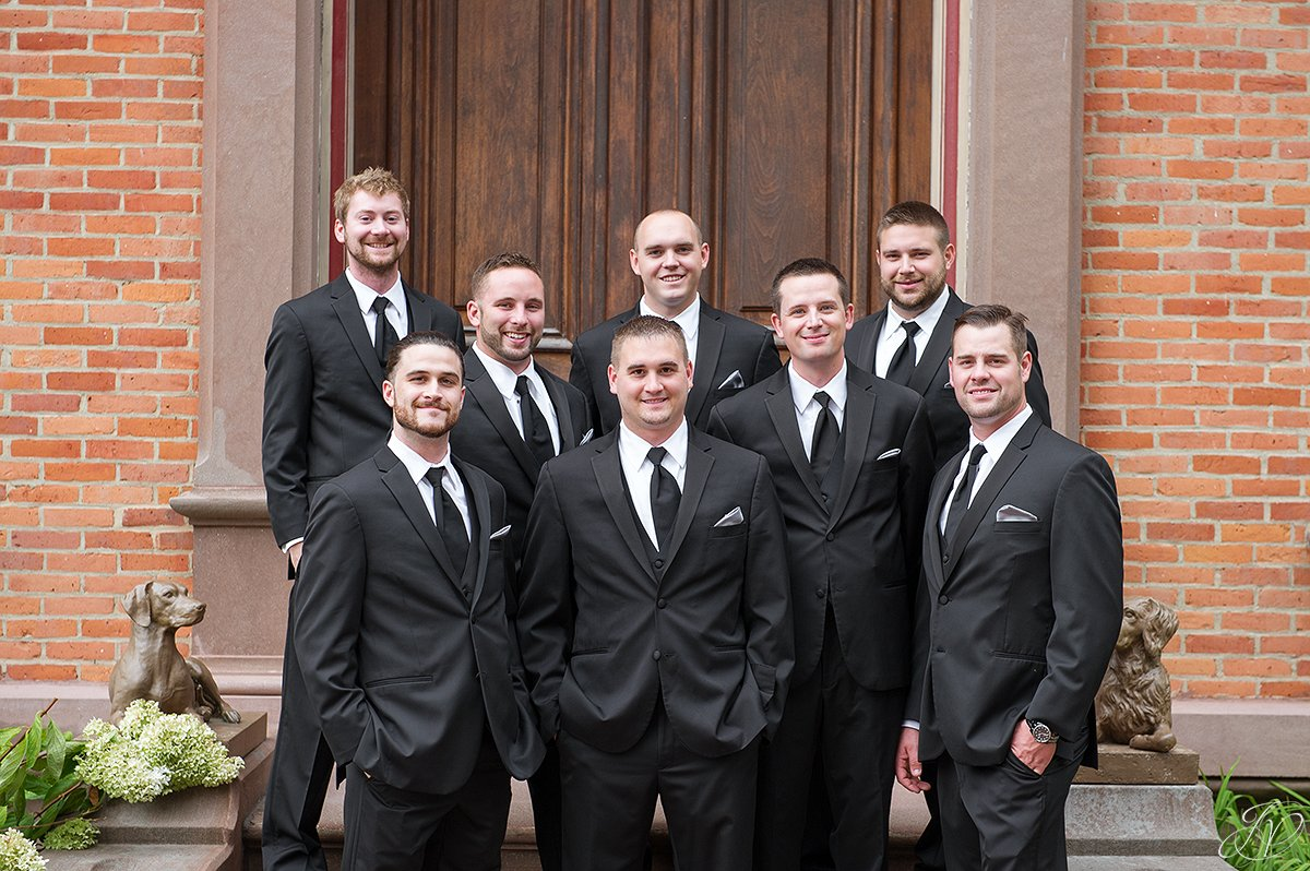 groomsmen outside of brick building canfield casino