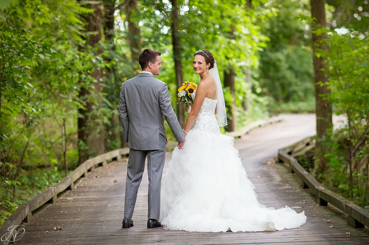 bride and groom on bridge walkway Timberlodge at Arrowhead Golf Club