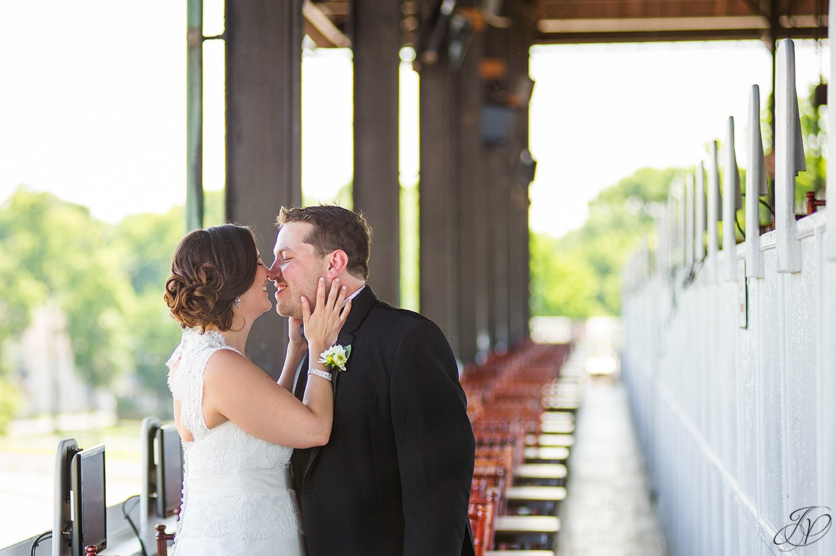 romantic photo of bride and groom at saratoga race track