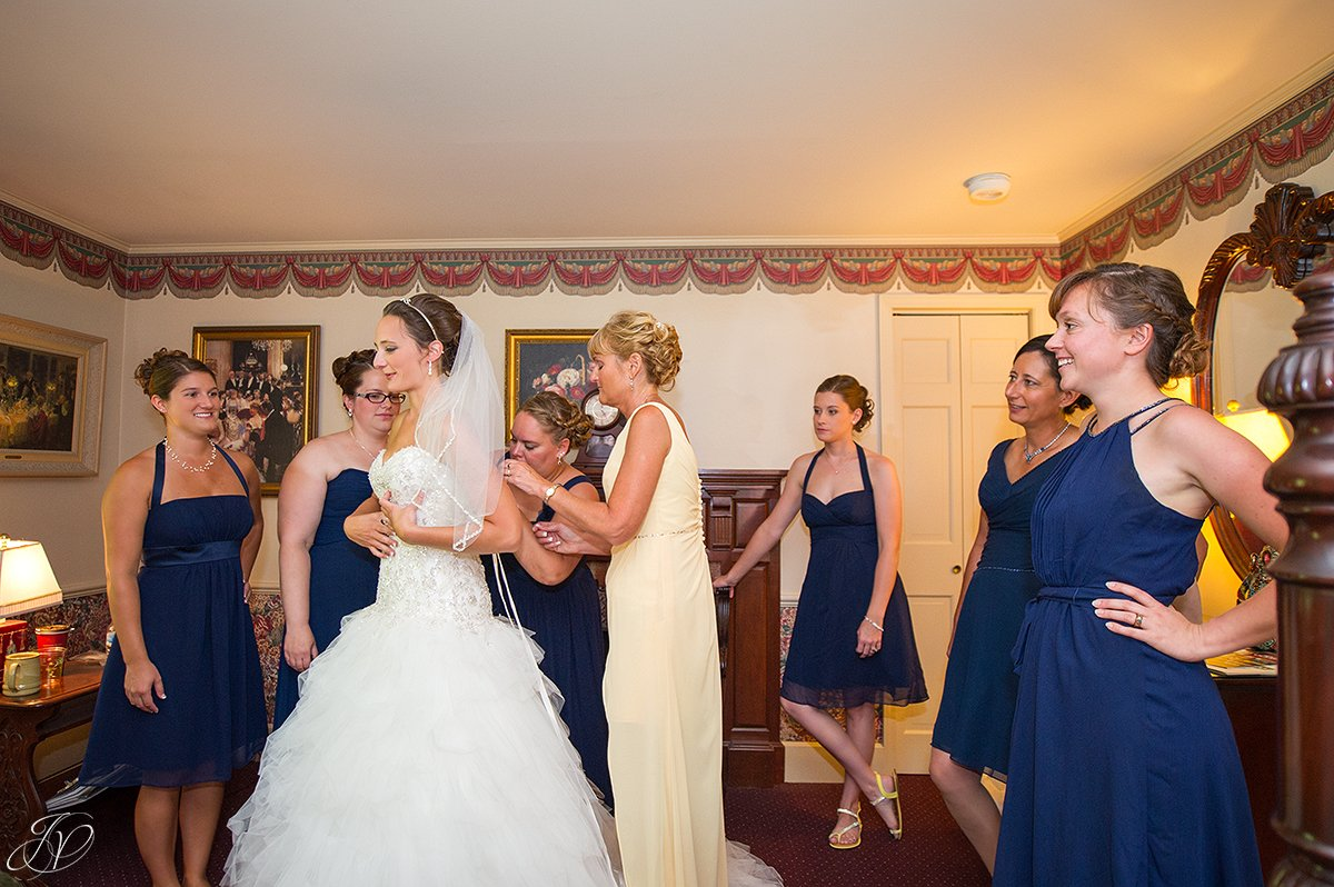 bride getting ready with mom and bridesmaids
