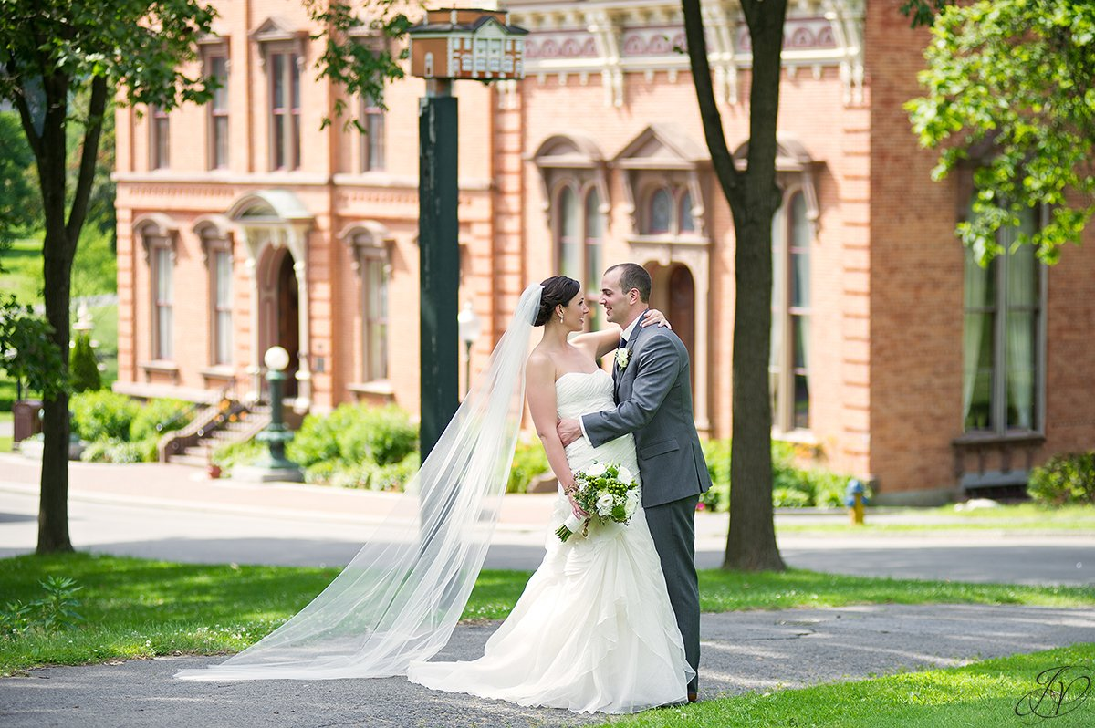 bride and groom photo in congress park with view of canfield casino saratoga springs