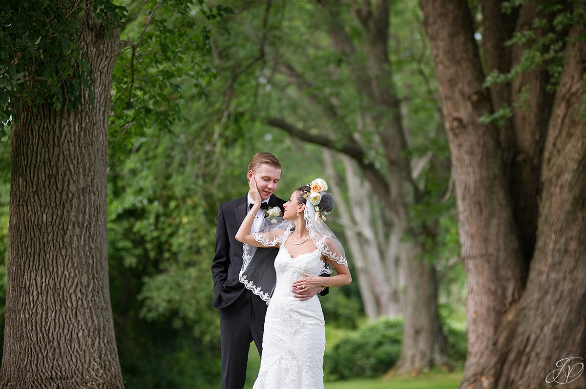 bride touching grooms face normanside country club