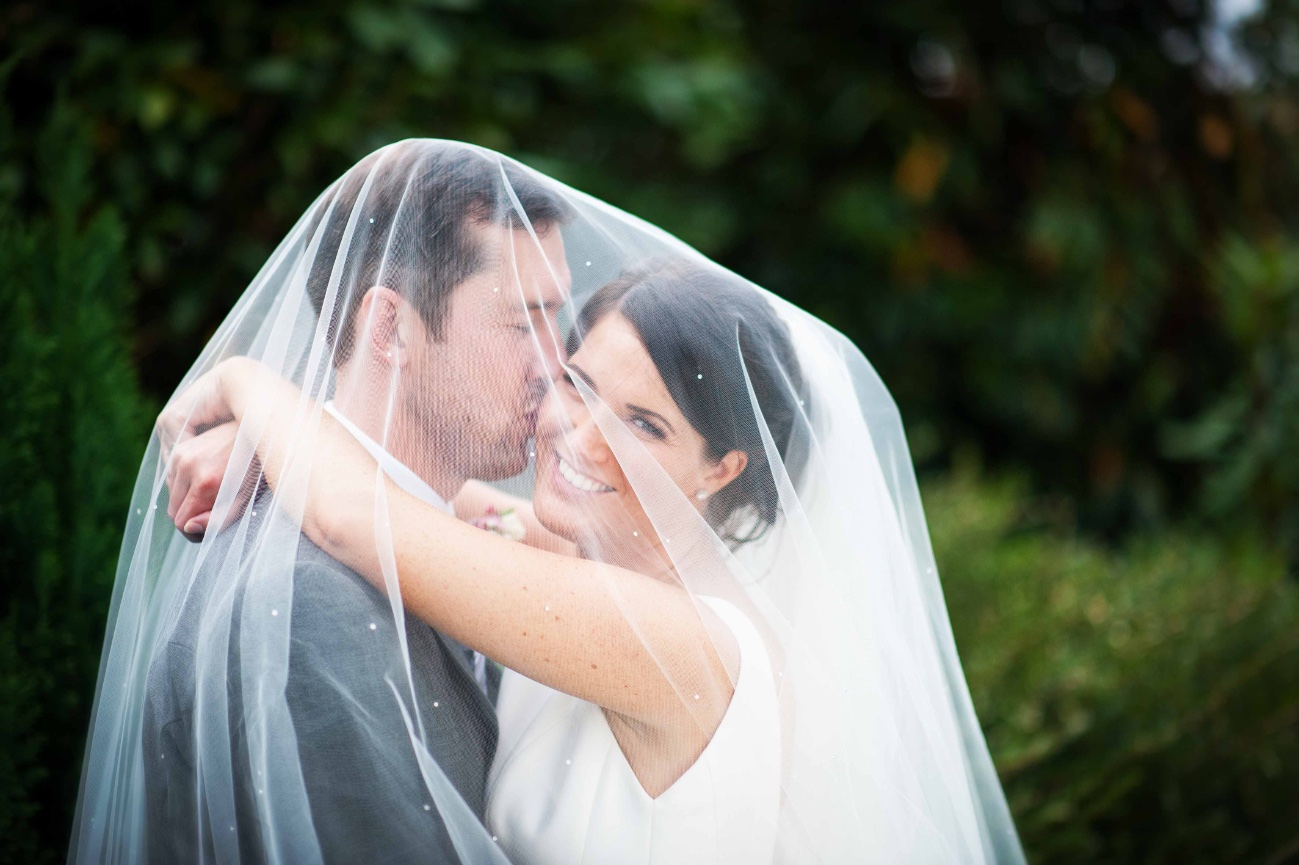 romantic bride and groom shot under the veil