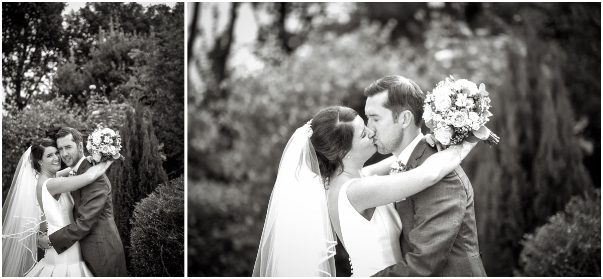 Wedding couple kissing' black and white