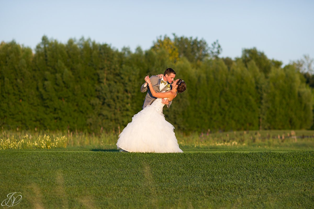 groom dipping bride sunset Arrowhead Golf Club