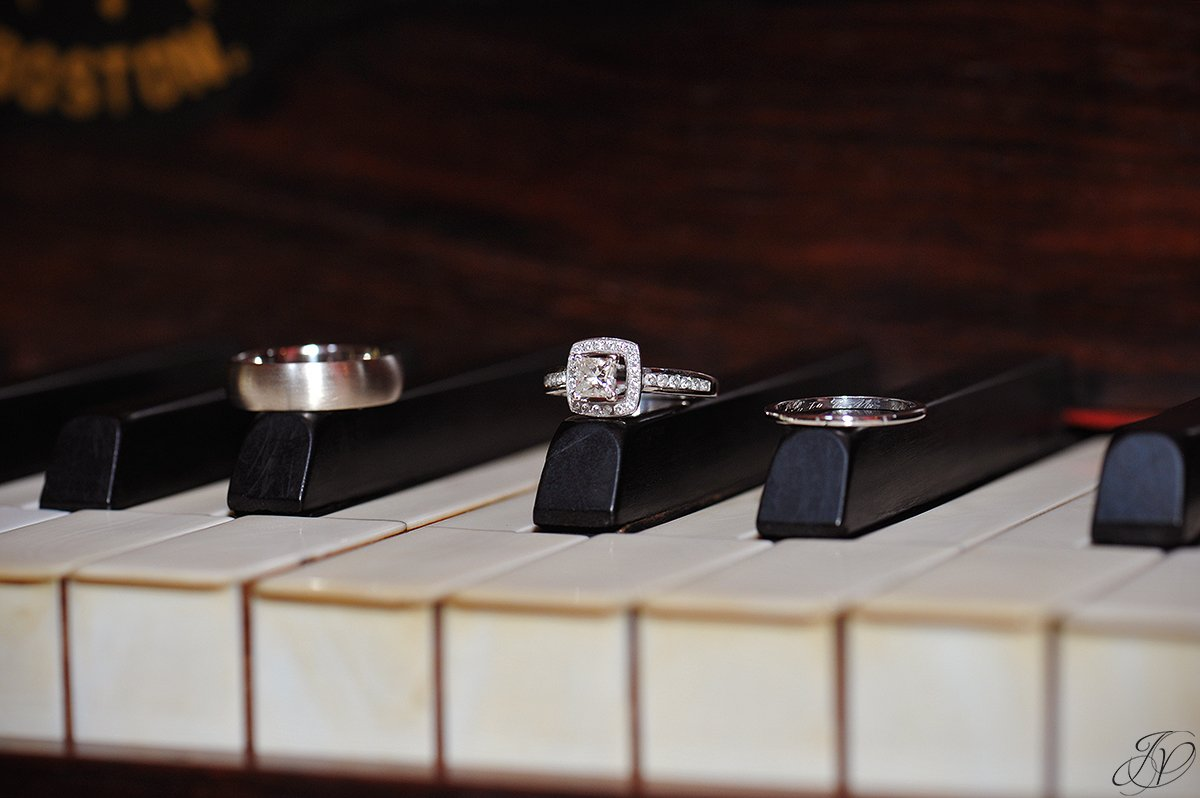 unique wedding rings photo on piano