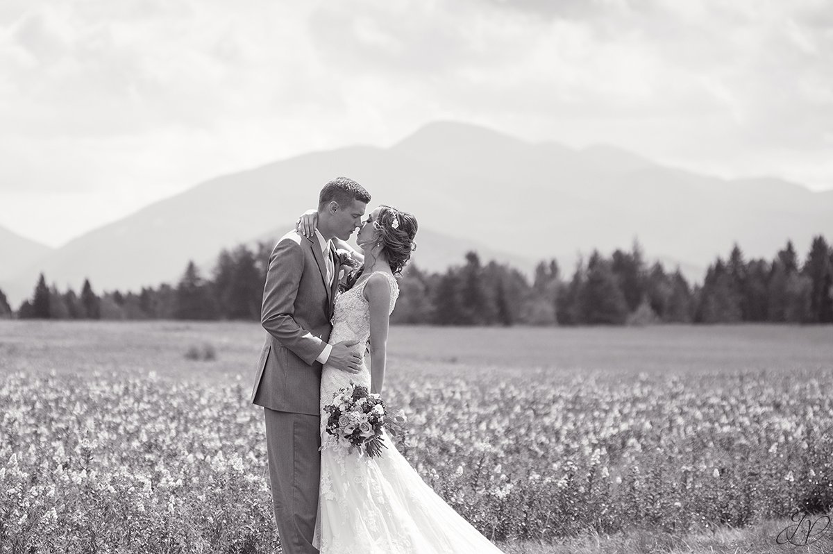 bridal portrait in front of mountain lake placid black and white