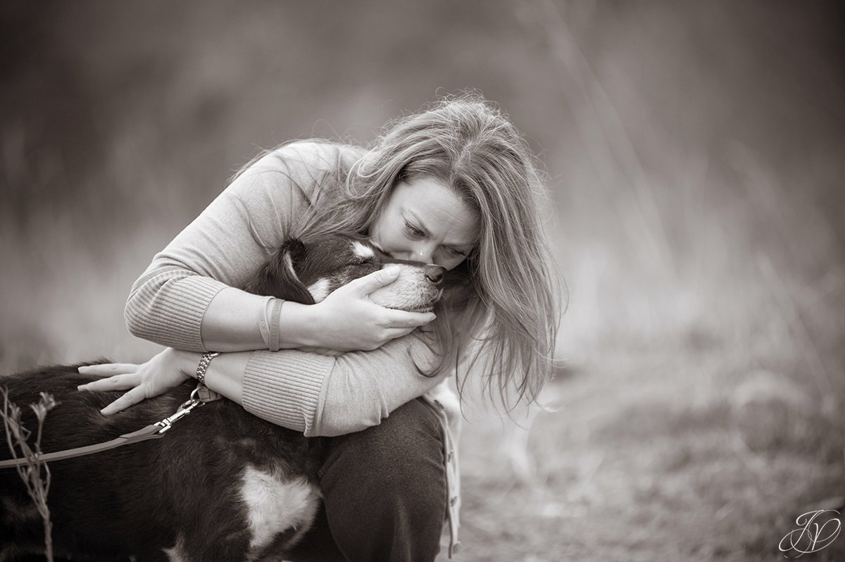 emotional photo of animal rescuer crying