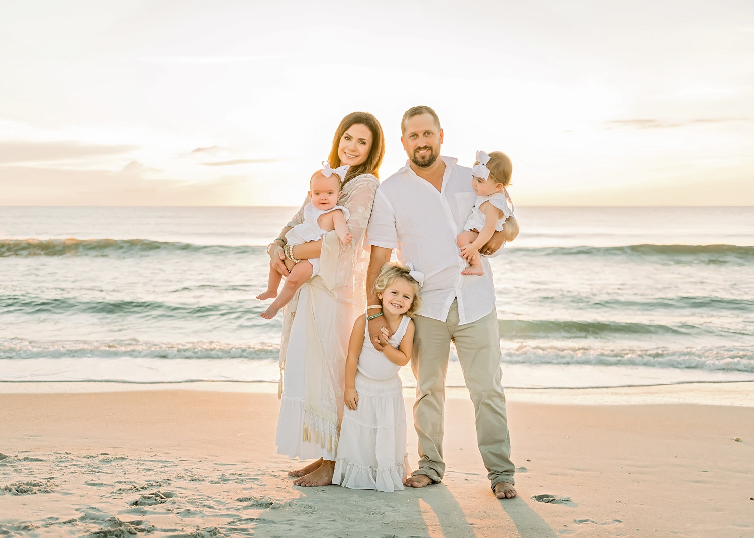 family of 5 looking at the camera, Ponte Vedra Beach sunrise photography