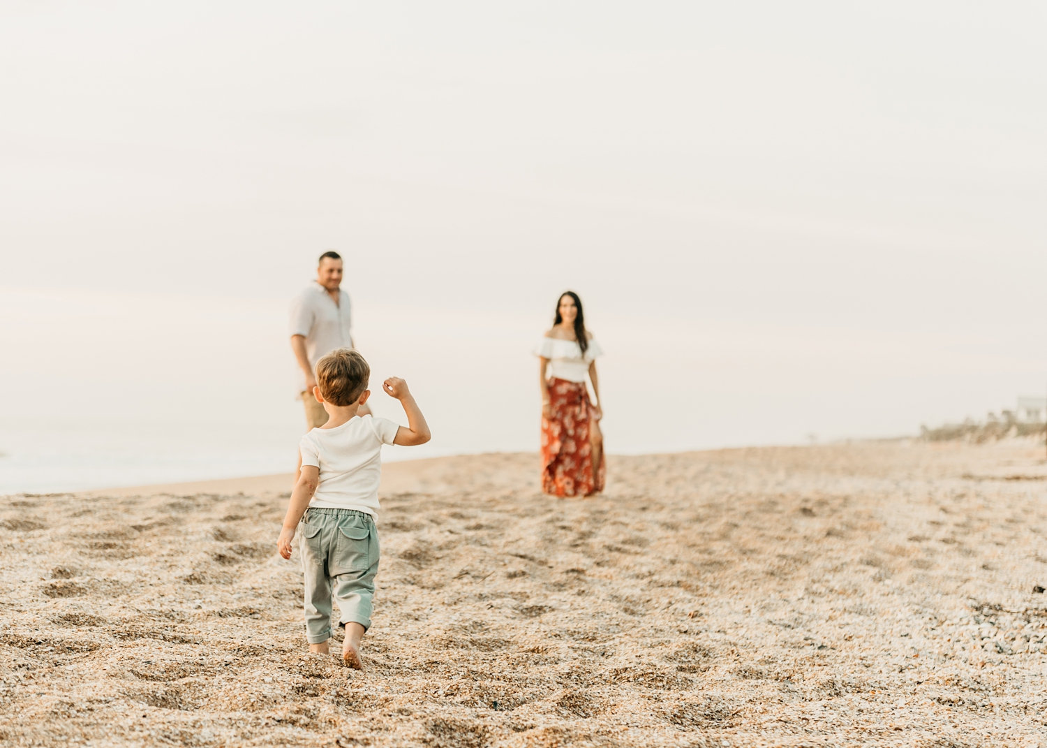 toddler walking toward parents, St. Augustine Beach, Florida, Rya Duncklee Photography