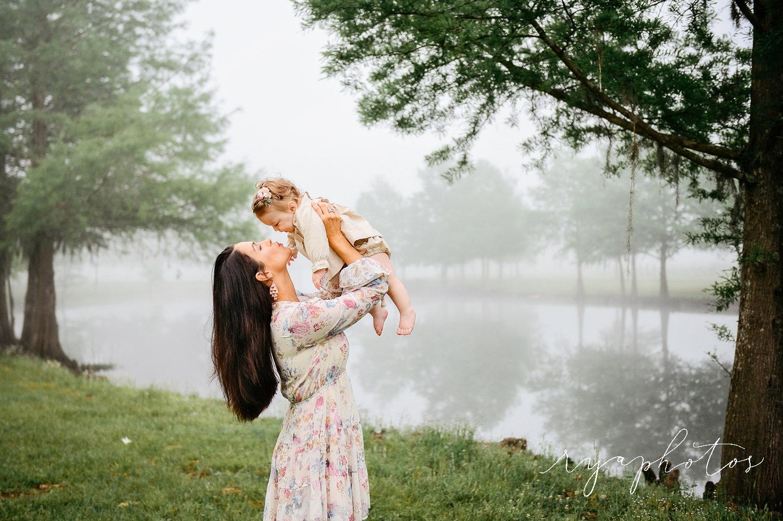 mother lifting up baby daughter, best Jacksonville motherhood photographer, Rya Duncklee