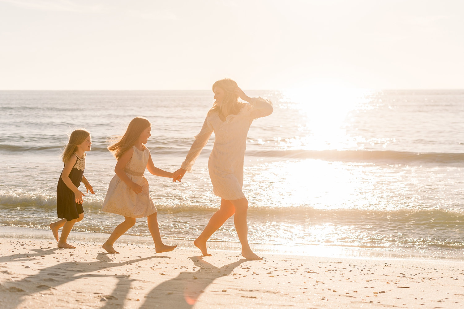mom and daughters walking along beach, Naples, Florida, Rya Duncklee