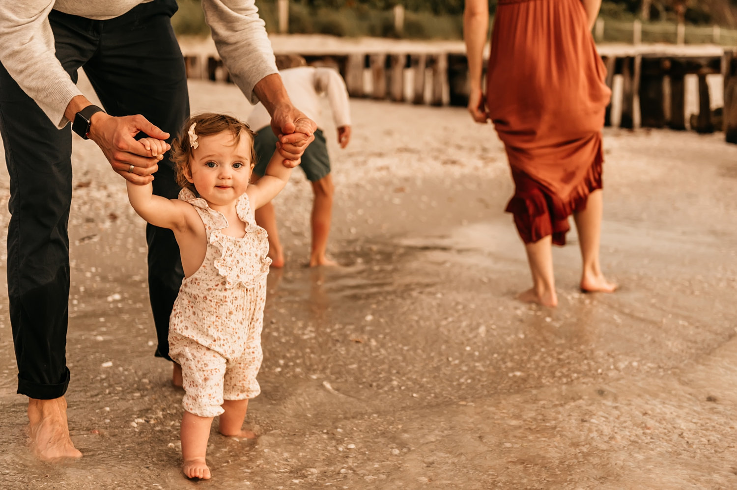 baby beach portrait with family in background, toes in the water, Rya Duncklee
