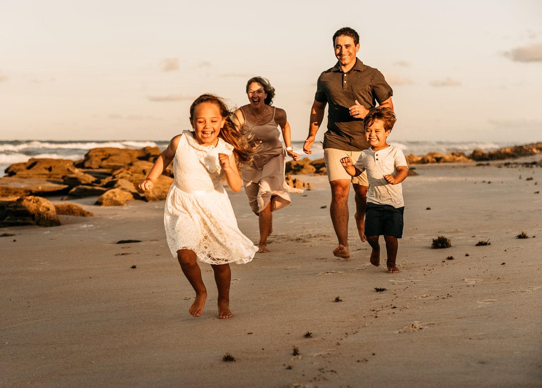 family of four running on Saint Augustine Beach, Florida, Rya Duncklee Photos