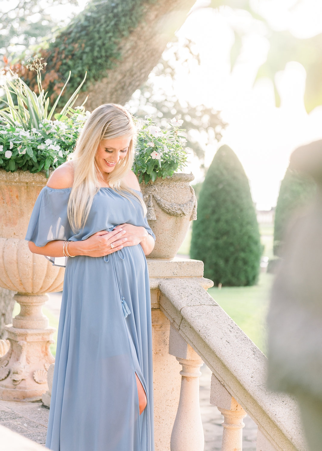 maternity photo, pregnant blonde woman with long blonde hair, wearing delicate jewelry and a strapless blue dress, Jacksonville, Florida